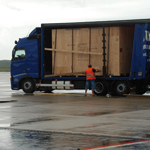International transport delivering export packed cargo airside to meet chartered  Antonov 124 for urgent air freight shipment
